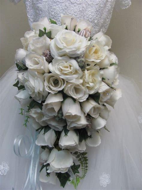 white rose cascade bridal bouquet  sea shells