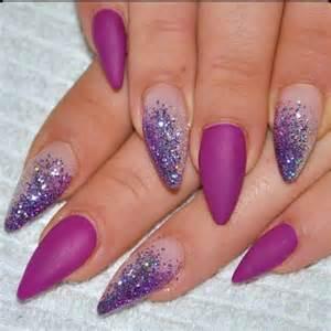 Matte purple almond acrylic nail art with sparkle glitter design