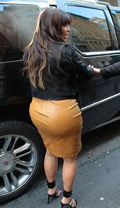 Pregnant Kim Kardashian Squeezes In To A Caramel Leather