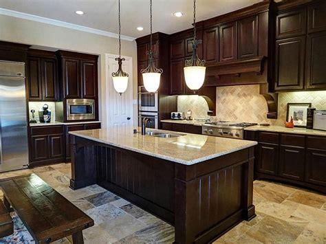 dark cabinets light granite light kitchen cabinets with dark granite countertops