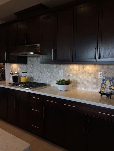 top dark brown kitchen cabinets espresso backsplash