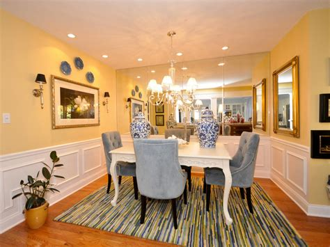 pale yellow dining room  mirrored wall  blue chairs