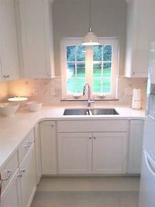Love the idea of a light hanging over kitchen sink