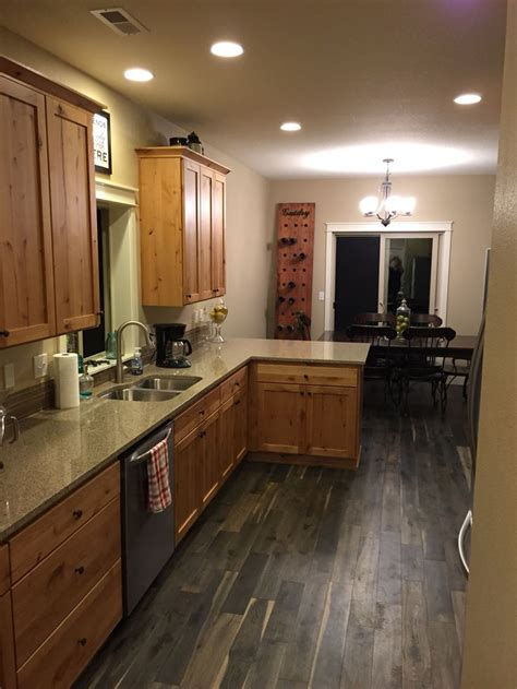 gray kitchen floors with oak cabinets kentwood iron oak springs floors with knotty alder