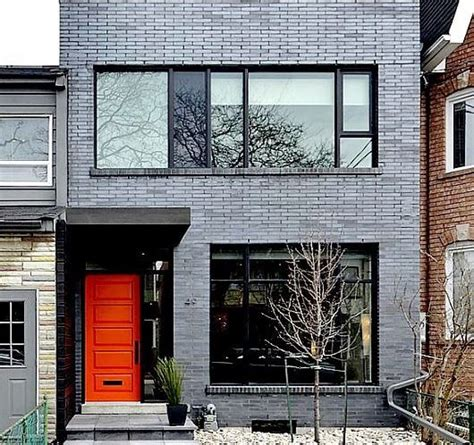 medium grey exterior  black trim brick exterior