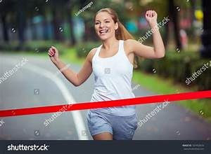 Young Girl Crosses Finish Line Stock Photo 167452616 ...