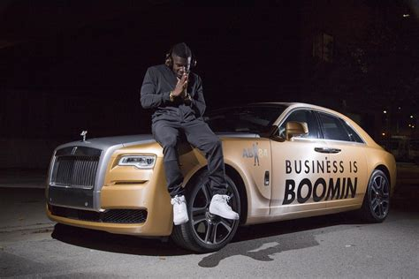 antonio brown sports rolls royce ghost wrapped  gold