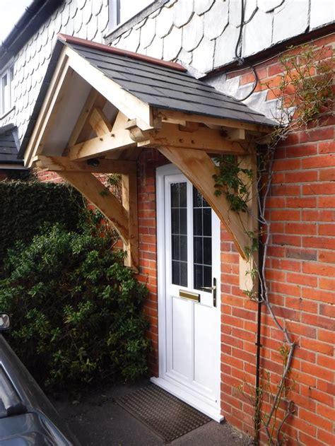 oak framed gallows bracket porch timber frame porch house  stilts patio roof