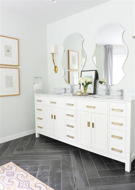 white vanity  brass pulls contemporary bathroom