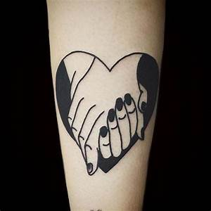 Black hands holding tattoo | Tattoo Inspiration ...