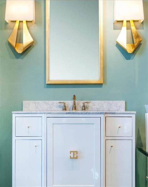 our bath vanity and clarissa sconces are looking