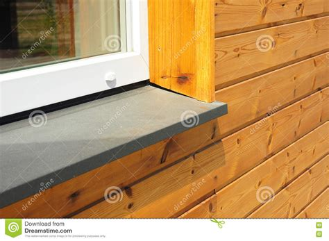 Exterior Window Sill Stock by New Window Sill Repair With House Facade Wooden Wall
