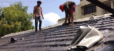 workers tarring mumbais roofs summer