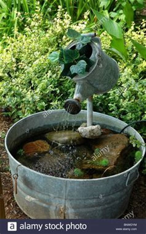 Water Fountain Made From Old Watering Can Wash