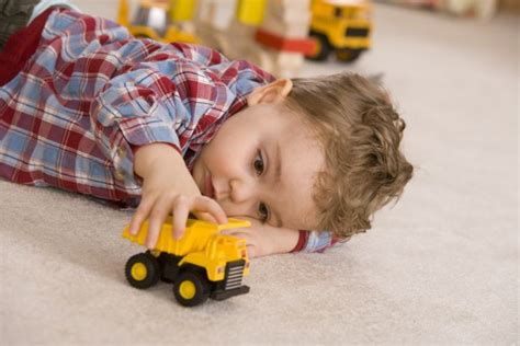 kid play car decrease in new cases of autism in uk after surge during 1990s