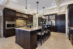 Fresh coat of paint light vs dark kitchens for Kitchens with dark wood cabinets