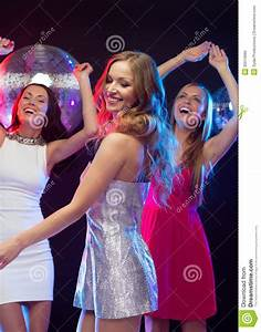 Three Smiling Women Dancing In The Club Stock Photo ...