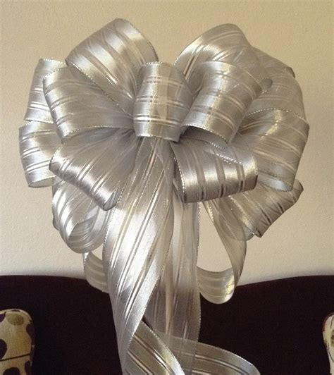 large silver tree topper christmas bow gift by basketsfromatoz