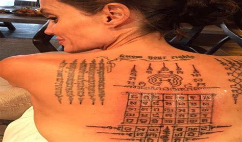 pour reconquerir brad angelina jolie se tatoue le dos