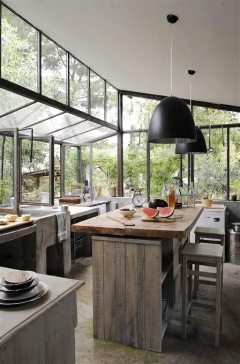 Open Natures Window With This Greenery Surrounded Home by A Wall Of Windows In The Kitchen Kitchen Masculine
