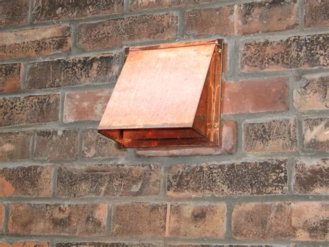 copper wall vent installed  brick