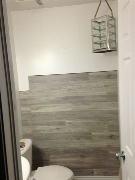 Laminate Tile Flooring For Bathroom by Bored To Floored Laminate Floor Accent Wall Diy