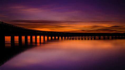 sunset scotland silhouette reflection landscape pier
