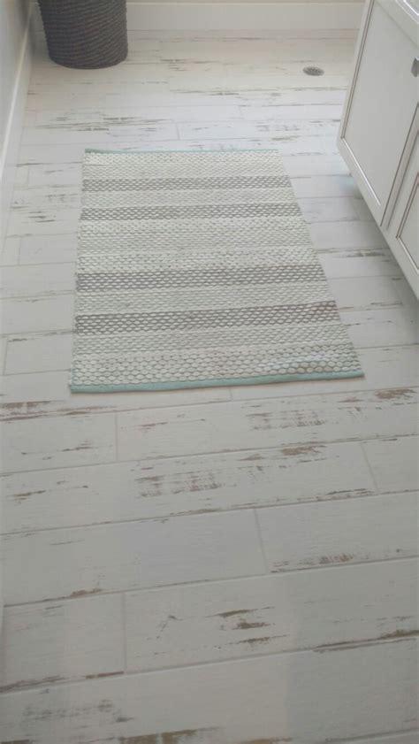 love  white washed wood  tile   laundry