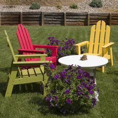 a range of colored plastic recycled adirondack chairs