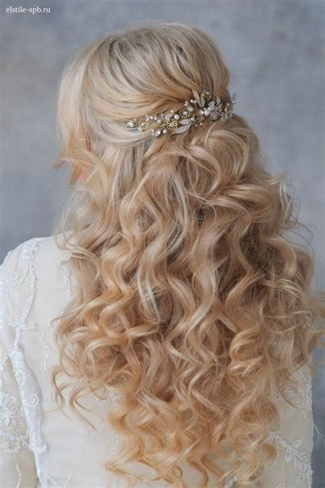 long wavy half up half down wedding hairstyle with pearl