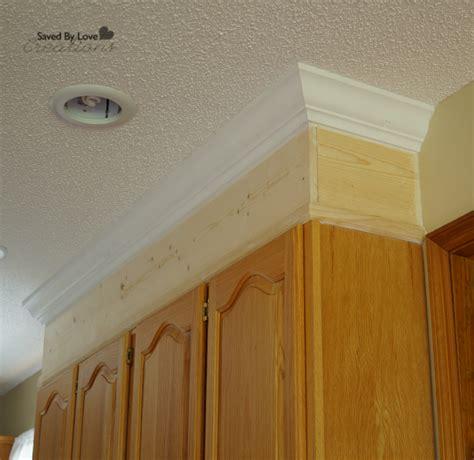 crown moulding above kitchen cabinets diy kitchen cabinet upgrade with paint and crown molding 8513