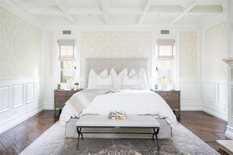 light gray button tufted headboard  cream damask wall