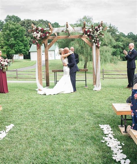 Rustic outdoor wedding ceremony Barnwood altar at The