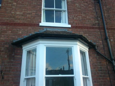 asbestos gutter removal  bay window demolition