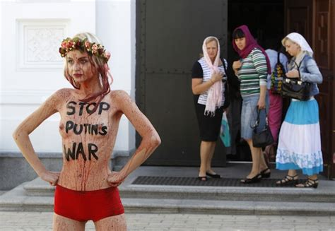women fined  topless protest  moscow