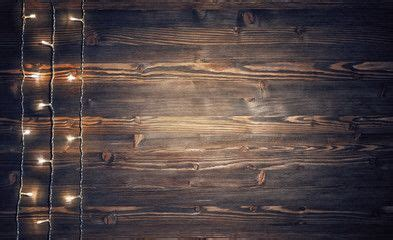 christmas lights  rustic wooden background rustic
