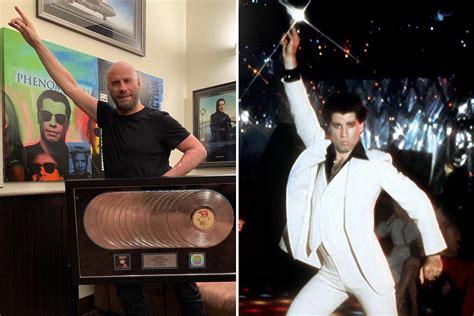 john travolta  nostalgic   recreates iconic