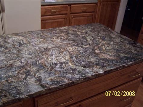 saturnia schist suede counters. Beautiful brown quartz
