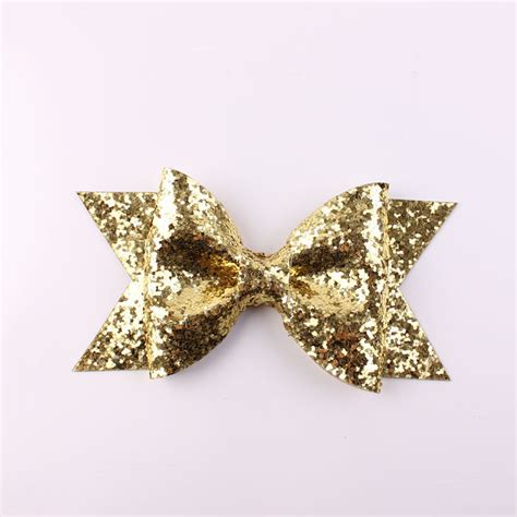 oversized large gold glitter fabric bow hair clip for