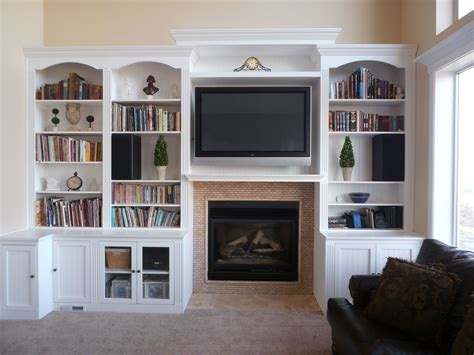 Living Room With Fireplace And Bookshelves by Fireplace With Hearth Center Bookcases On Sides