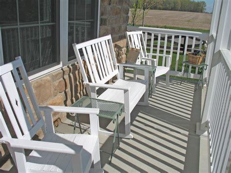 white wooden front porch bench set with small outdoor