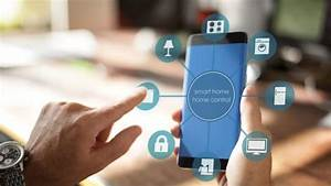 Smart Home Control : smart home man using smart home app on a smart phone smart home intelligent house automation ~ Watch28wear.com Haus und Dekorationen