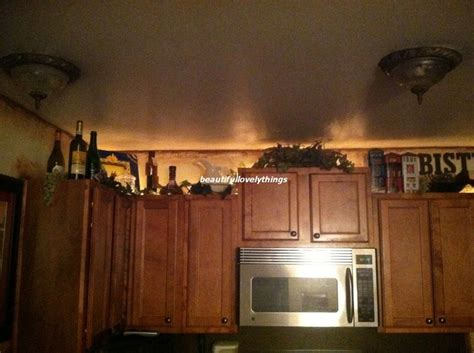 ideas for space above kitchen cabinets wine themed kitchen what to do with the space above