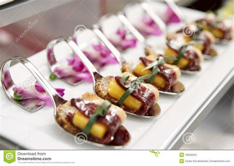 table canape canapes with cured ham on banquet table stock images