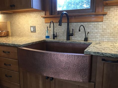 Hammered copper farm house sink with Cambria Bradshaw