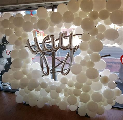 lovely organic white balloon wall  select hard wood
