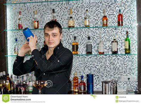 How To Make Bartending Sound Professional On A Resume by Bartender Mixing Liquors With The Cocktail Shaker Stock Photo Image 35534546