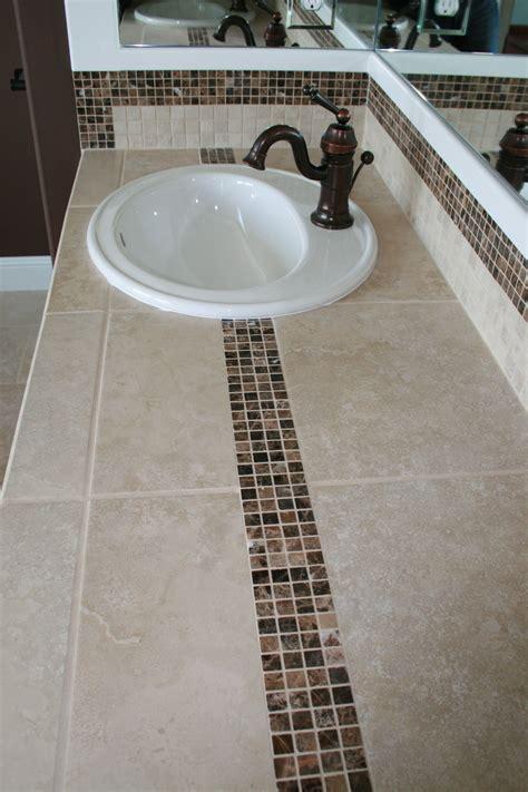 tiled bath counter top  dark marble accent tile tile