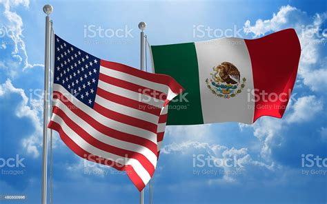 United States And Mexico Flags Flying Together For ...