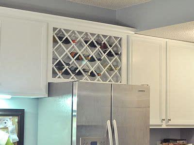 adding cabinets to kitchen wine rack diy above fridge house wine rack 3989